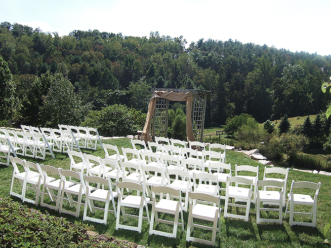 Outdoor wedding ceremony set up with arch in Glasbern Fogelsville, PA