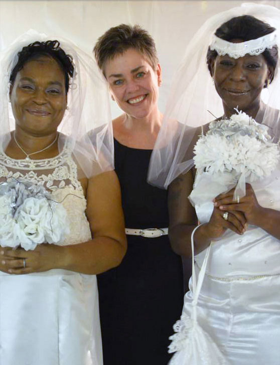 Reverend Kathleen with 2 brides