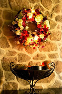 The Inn At Leola Village stone walls with fall centerpiece