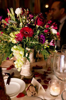 The Inn At Leola Village floral centerpiece with white grapes and red roses
