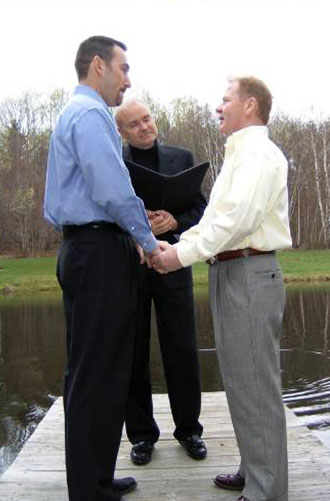 Moose Meadow Lodge - Gay wedding ceremony performed outdoors waterside