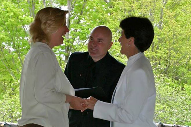 Moose Meadow Lodge - Officiant performing lesbian wedding ceremony