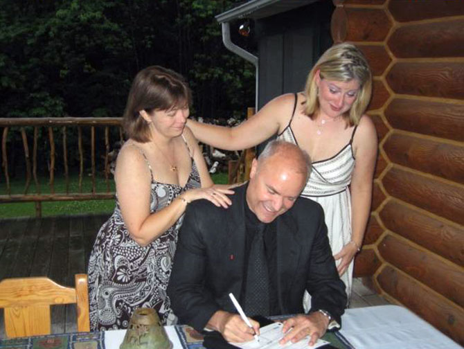 Moose Meadow Lodge - LGBT wedding officiant signing marriage license