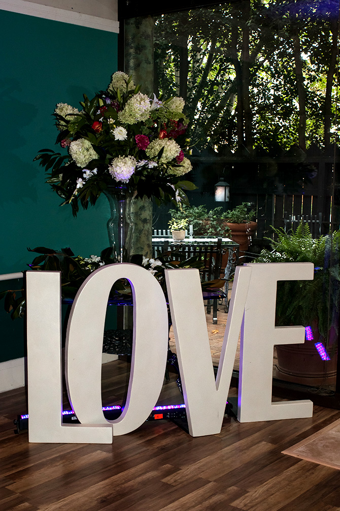 Butler's Unique Catering & Events - Large LOVE and floral centerpiece