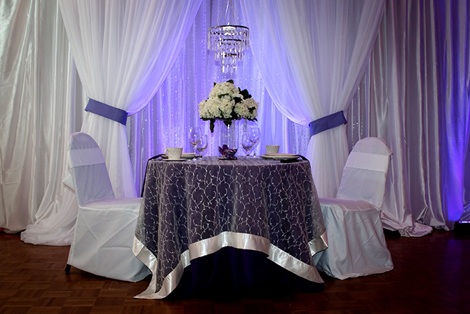 Butler's Unique Catering & Events - Crystal Chandelier and table for two