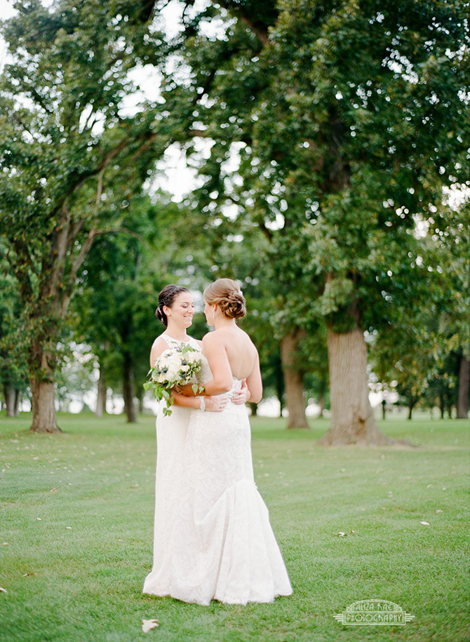 Lesbian wedding day embrace - Lake Lawn Resort in Wisconsin