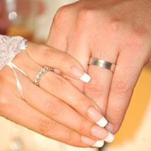 Trinity Hawaiian Weddings - Candid shot of couple's hands and wedding rings