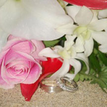 Trinity Hawaiian Weddings - Red rose and white orchids