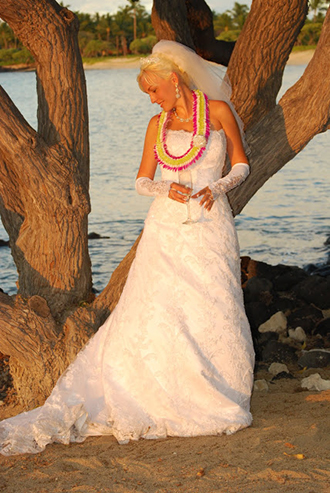 Trinity Hawaiian Weddings - Bride Posing Near A Tree On The Beach