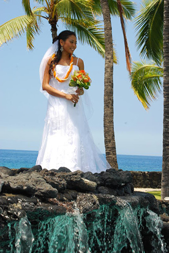 Trinity Hawaiian Weddings - Bride Posing Near A Water Fall